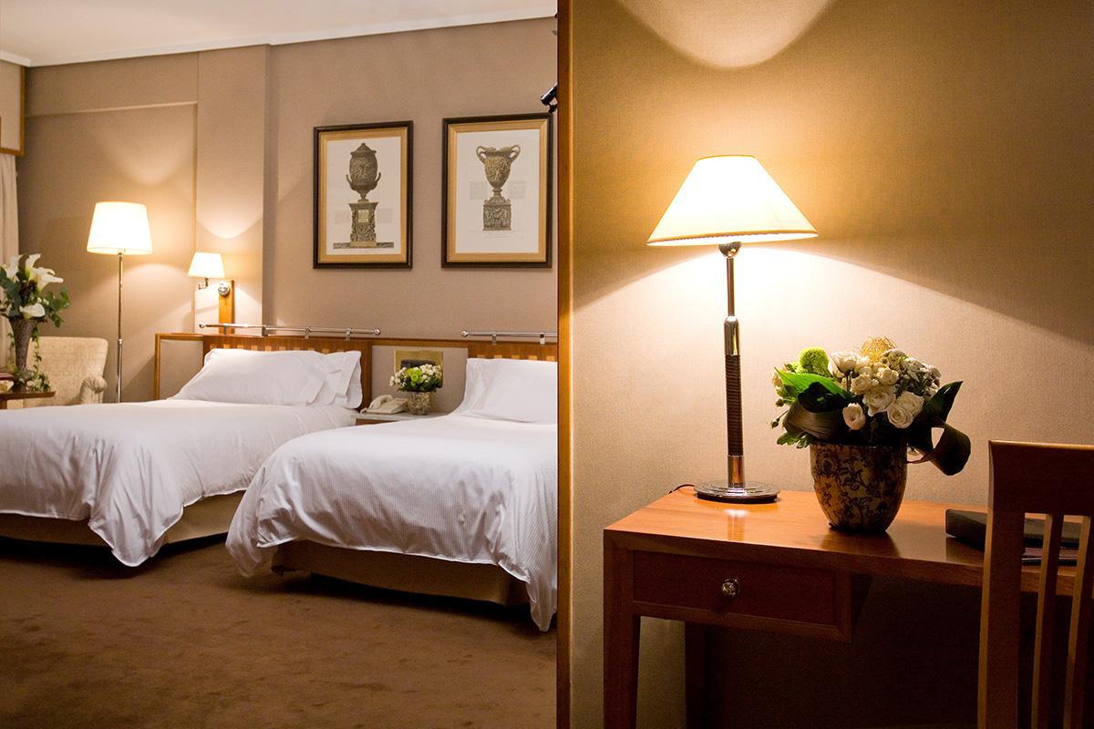 Habitaciones hotel palafox palafox hoteles for Detalles en habitaciones de hotel