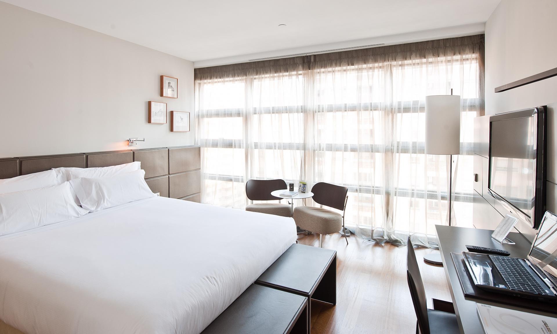 Habitaciones hotel reina petronila palafox hoteles for Detalles en habitaciones de hotel